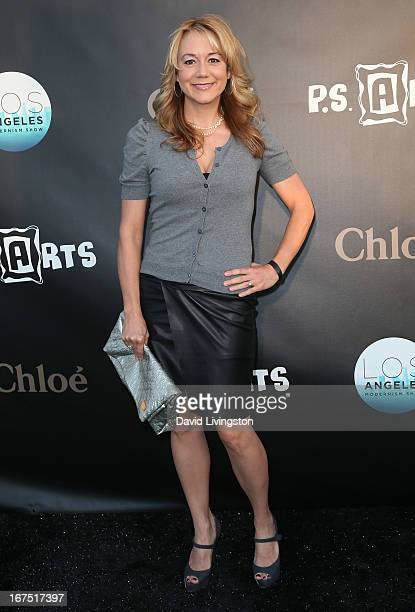 Actress Megyn Price attends the Los Angeles Modernism Show Sale at Barker Hangar on April 25 2013 in Santa Monica California
