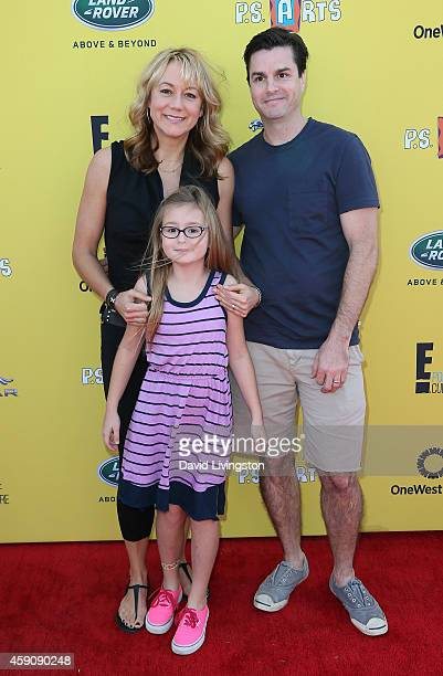 Actress Megyn Price, Grace Price and Dr. Edward Cotner attend P.S. ARTS Express Yourself 2014 at the Barker Hanger on November 16, 2014 in Santa...