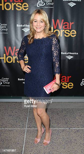 Actress Megyn Price poses during the arrivals for the opening night performance of War Horse at Center Theatre Group/Ahmanson Theatre on June 29 2012...