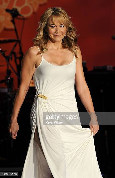 Actress Megyn Price walks the runway during the 17th Annual Race to Erase MS event cochaired by Nancy Davis and Tommy Hilfiger at the Hyatt Regency...