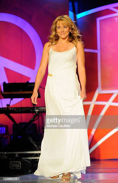Actress Megyn Price walks the runway onstage during the 17th Annual Race to Erase MS event cochaired by Nancy Davis and Tommy Hilfiger at the Hyatt...