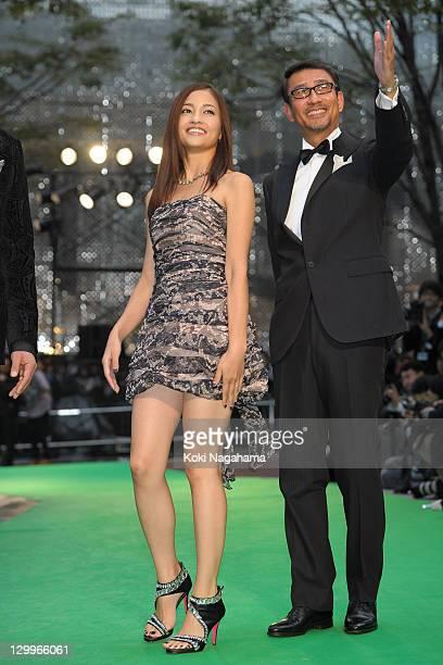 Actress Meisa Kuroki and actor Kiichi Nakai walk on the green carpet during the Tokyo International Film Festival Opening Ceremony at Roppongi Hills...