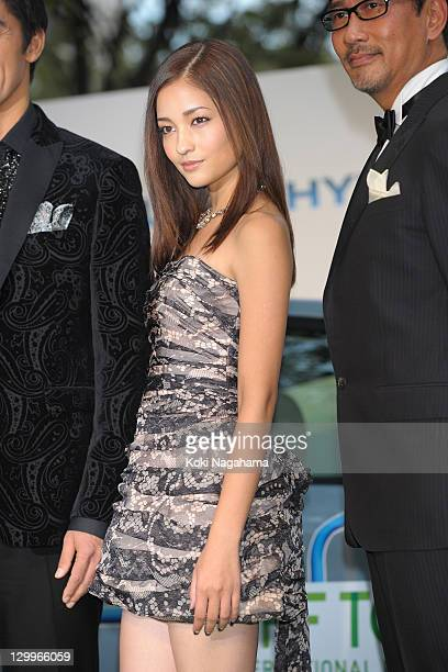Actress Meisa Kuroki poses on the green carpet during the Tokyo International Film Festival Opening Ceremony at Roppongi Hills on October 22 2011 in...