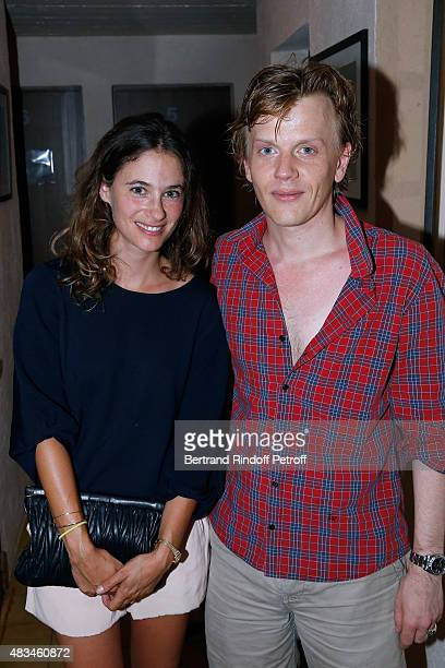 Actress Melanie Bernier and Humorist Alex Lutz pose Backstage after the Alex Lutz Show during the 31th Ramatuelle Festival Day 8 on August 8 2015 in...