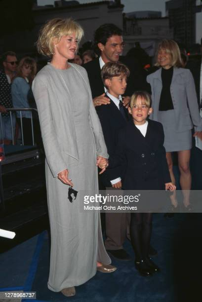 "Actress Melanie Griffith, actor Antonio Banderas, Melanie's daughter Dakota Johnson and Melanie's son Alexander Bauer attend the ""Batman & Robin""..."