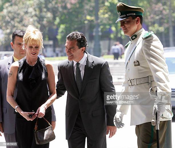 US actress Melanie Griffith and her husband Spanish actor Antonio Banderas arrive at La Moneda presidential palace in Santiago to meet with Chilean...