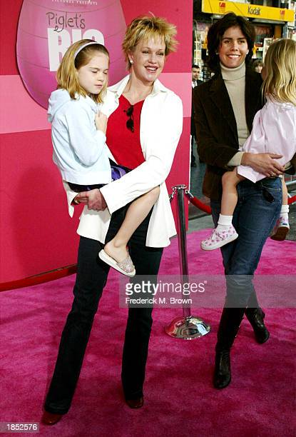 Actress Melanie Griffith Don Johnson's wife Kelley Phleger and kids attend the film premiere of Piglet's Big Movie at the El Capitan Theater on March...