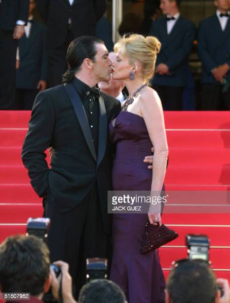 US actress Melanie Griffith guest of honour of the 54th Cannes Film Festival kisses her husband Spanish actor Antonio Banderas upon her arrival at...