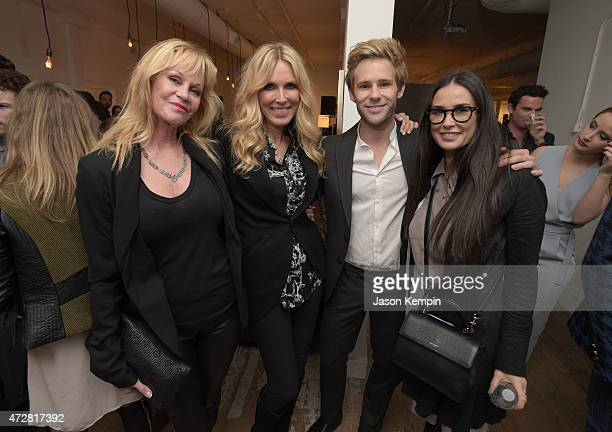 Actress Melanie Griffith producer Alana Stewart artist Bryan Fox and actress Demi Moore attend We Alone a photography exhibit by Bryan Fox at Think...