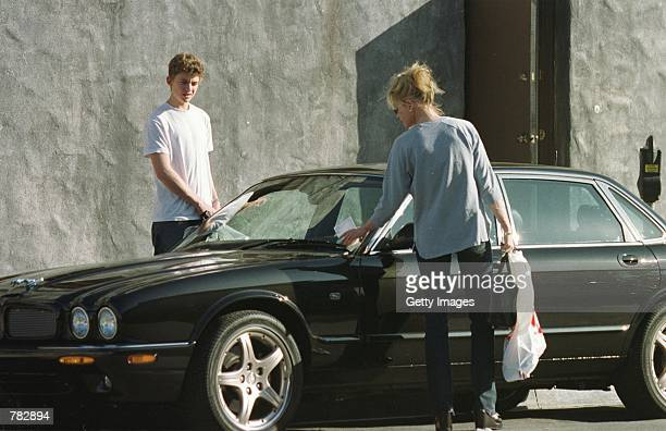 Actress Melanie Griffith returns to her car to find a parking ticket on her windshield January 2 2001 in West Hollywood CA