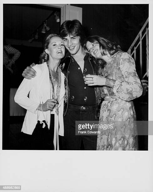 Actress Melanie Griffith with her boyfriend actor Don Johnson and her mother actress Tippi Hedren attending a party California October 26th 1973