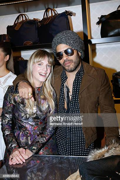 Actress Melanie Laurent and singer Lenny Kravitz attend the Longchamp Elysees 'Lights On Party' Boutique Launch on December 4 2014 in Paris France