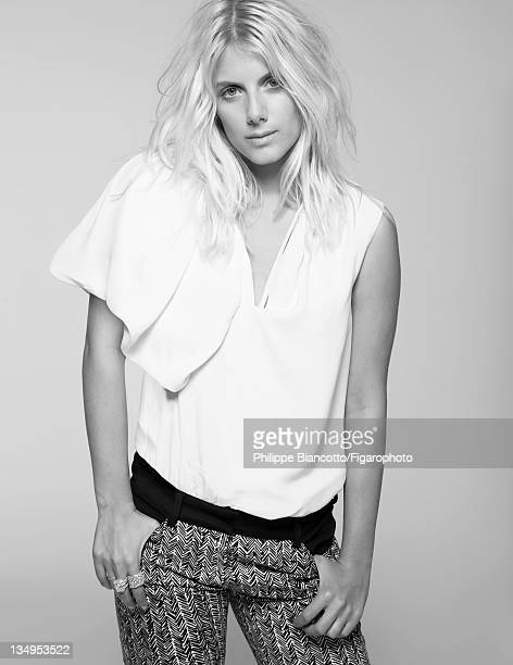 Actress Melanie Laurent is photographed for Madame Figaro on October 10, 2011 in Paris, France. Figaro ID:101927-010. Shirt and jeans by Nicolas...