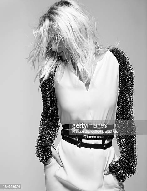 Actress Melanie Laurent is photographed for Madame Figaro on October 10, 2011 in Paris, France. Figaro ID:101927-011. Dress by 3.1 Philip Lim, belt...