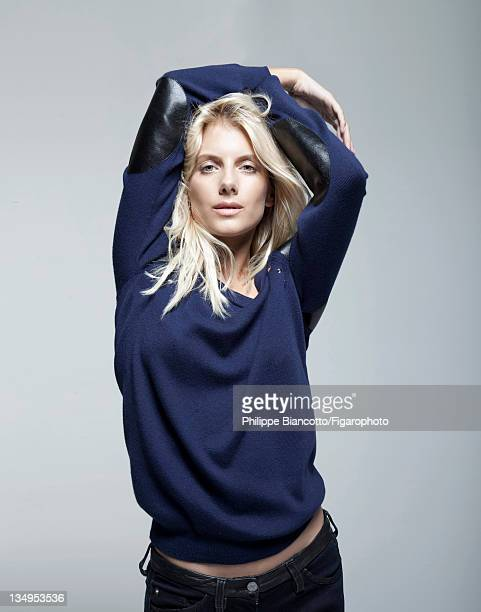 Actress Melanie Laurent is photographed for Madame Figaro on October 10, 2011 in Paris, France. Figaro ID:101927-018. Sweater by Louis Vuitton, jeans...