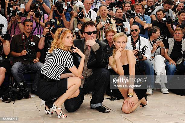 Actress Melanie Laurent with director Quentin Tarantino and Diane Kruger attends the Inglourious Basterds Photocall held at the Palais Des Festivals...