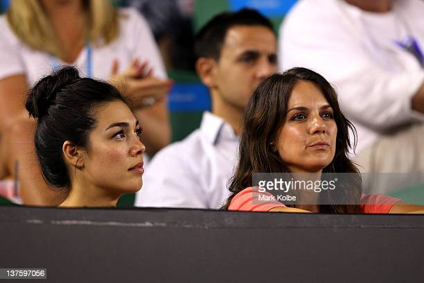 Actress Melanie Vallejo and Michala Banas watch the fourth round match between Lleyton Hewitt of Australiaand Novak Djokovic of Serbia during day...