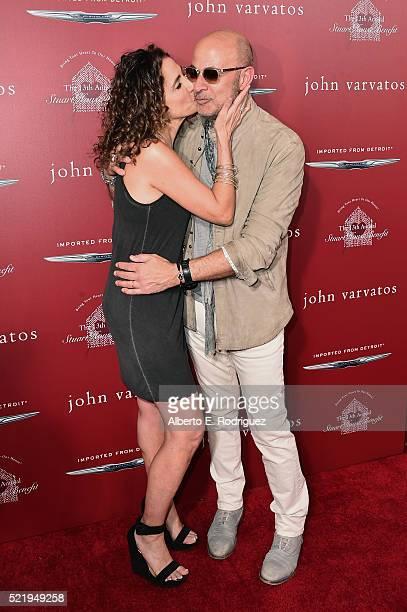 Actress Melina Kanakaredes and fashion designer John Varvatos attend the John Varvatos 13th Annual Stuart House benefit presented by Chrysler with...
