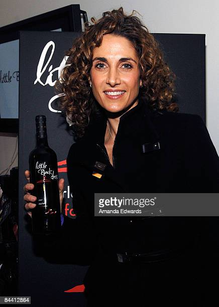 Actress Melina Kanakaredes poses at Little Black Dress Wines at Kari Feinstein Golden Globes Style Lounge held at Zune LA on January 9, 2009 in Los...