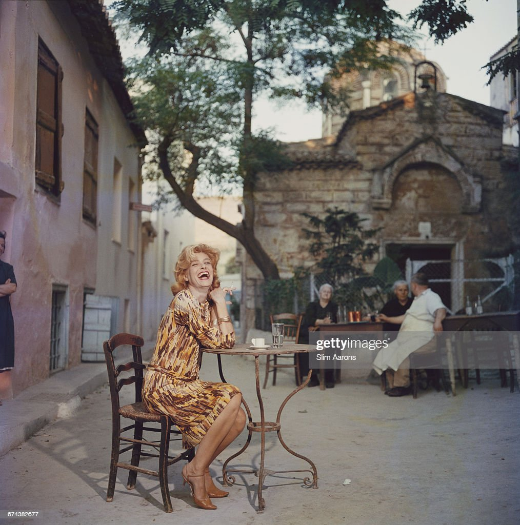 Actress Melina Mercouri enjoys a coffee and a cigarette at a quiet pavement cafe, Plaka, Athens, 1961.