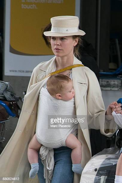 Actress Melissa George and son Solal Samuel Glenn Blanc arrive at Nice airport during the annual 69th Cannes Film Festival on May 11 2016 in Nice...
