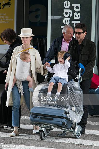 Actress Melissa George her sons Solal Samuel Glenn Blanc and Raphael Blanc and companion JeanDavid Blanc arrive at Nice airport during the annual...
