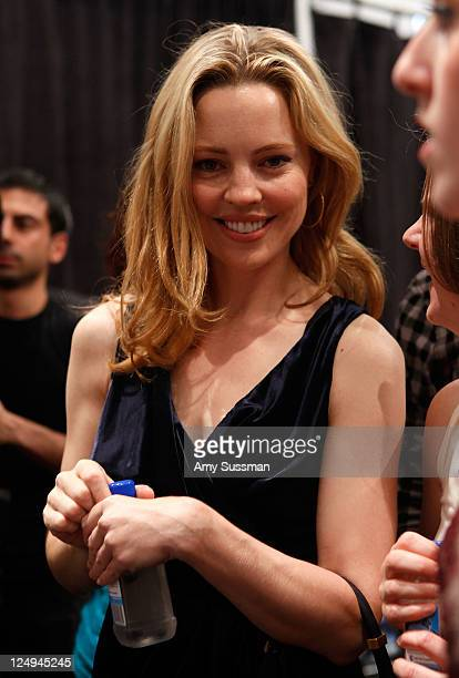 Actress Melissa George poses with FIJI Water at the J Mendel Spring 2012 show during MercedesBenz Fashion Week on September 14 2011 in New York City
