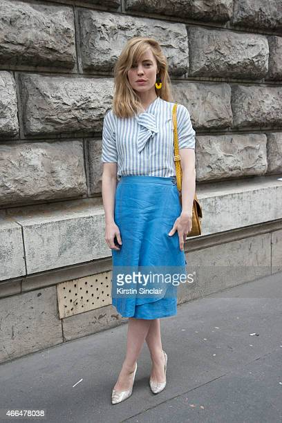 Actress Melissa George wears vintage 70's Hermes bag shirt skirt and earrings with Manolo Blahnik shoes on day 7 of Paris Collections Women on March...