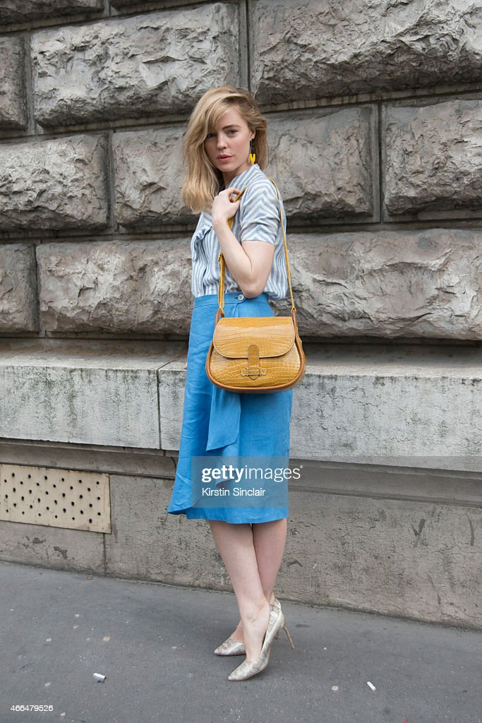 Actress Melissa George wears vintage 70's Hermes bag, shirt, skirt and earrings with Manolo Blahnik shoes on day 7 of Paris Collections: Women on March 09, 2015 in Paris, France.