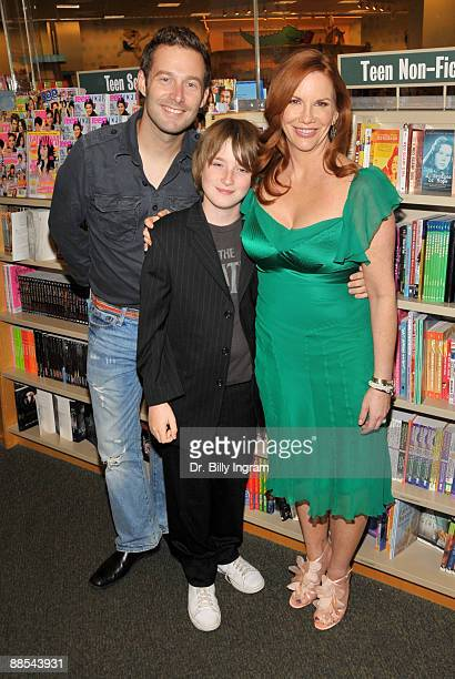 Actress Melissa Gilbert poses with her sons Sam Boxleitner and Michael Boxleitner at the signing of her book Prairie Tale A Memoir at Barnes Noble...