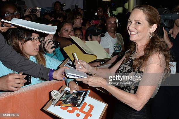 Actress Melissa Leo signs autographs for fans at The Equalizer premiere during the 2014 Toronto International Film Festival at Roy Thomson Hall on...