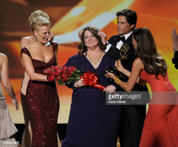 Actress Melissa McCarthy accepts the Outstanding Lead Actress in a Comedy Series award onstage with Martha Plimpton Rob Lowe and Sophia Vergara...