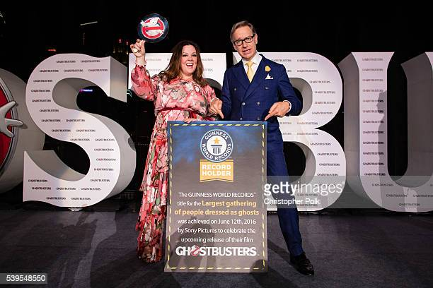 """Actress Melissa McCarthy and writer/director Paul Feig attend the """"Ghostbusters"""" red carpet and Guinness World Record event at Marina Bay Sands on..."""