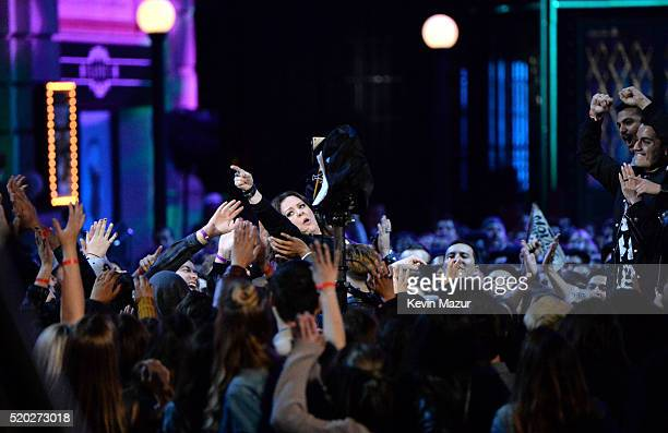 Actress Melissa McCarthy crowd surfs her way to accept the Comedic Genius Award during the 2016 MTV Movie Awards at Warner Bros Studios on April 9...