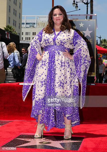 Actress Melissa McCarthy poses as she is honored with a star on the Hollywood Walk Of Fame on May 19 2015 in Hollywood California