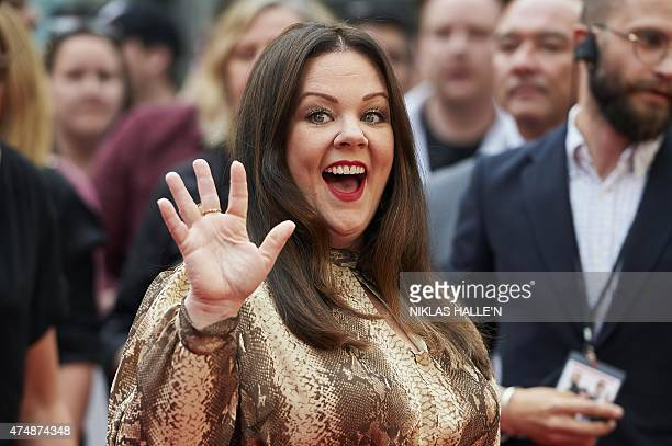 US actress Melissa McCarthy poses for photographs on the carpet as she arrives to attend the European premiere of the film 'Spy' in London on May 21...