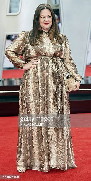 US actress Melissa McCarthy poses for photographs on the carpet as she arrives to attend the European premiere of the film 'Spy' in London on May 27...