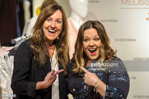Actress Melissa McCarthy right poses with a fan during a promotion for her fashion line Melissa McCarthy Seven7 at Nordstrom Downtown Seattle on July...