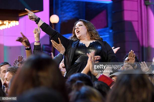 Actress Melissa McCarthy winner of the Comedic Genius award crowdsurfs to the stage during the 2016 MTV Movie Awards at Warner Bros Studios on April...