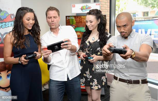 Actress Melissa O'Neil actor Anthony Lemke actress Jodelle Ferland and actor Alex Mallari Jr stopped by Nintendo at the TV Insider Lounge to check...