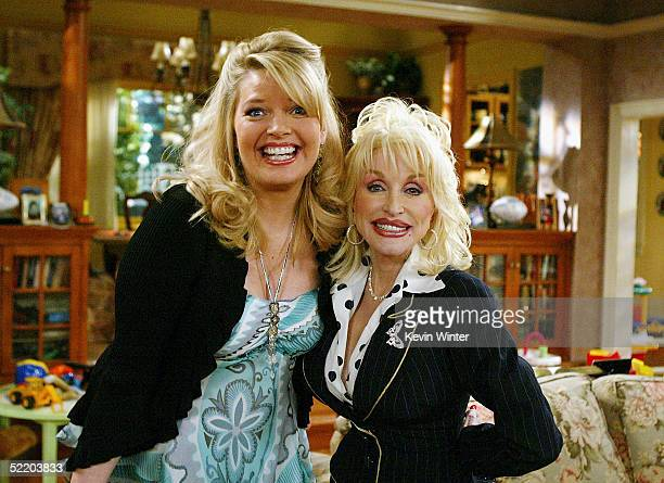 Actress Melissa Peterman and singer Dolly Parton pose on the set of The WB's Reba at 20th Century Fox Studios on February 15 2005 in Los Angeles...