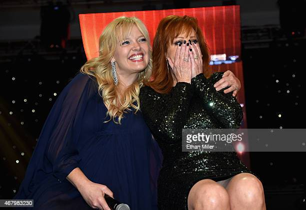 Actress Melissa Peterman and singer Reba McEntire onstage during Muhammad Ali's Celebrity Fight Night XXI at the Jw Marriott Phoenix Desert Ridge...