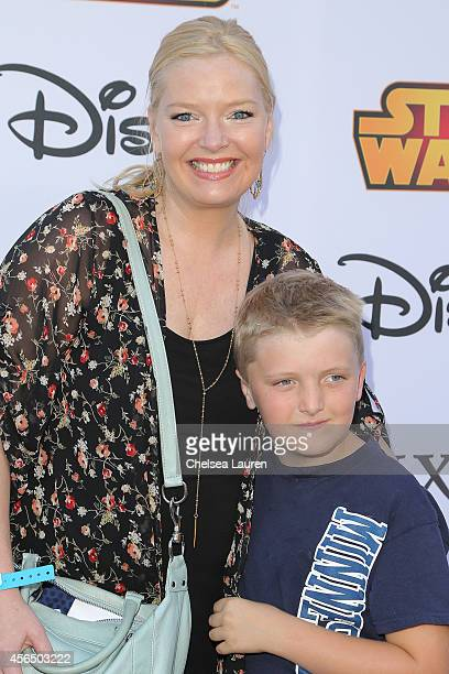 Actress Melissa Peterman and son Riley David Brady attend Disney's VIP halloween event at Disney Consumer Products Campus on October 1 2014 in...
