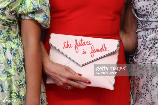 US actress Melora Hardin poses with a purse reading 'The Future is Female' during the opening of the 58th MonteCarlo Television Festival on June 15...