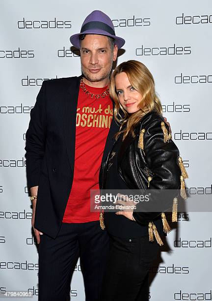 Actress Mena Suvari and Decades owner Cameron Silver arrive at the Decades Les Must De Moschino event at Decades on March 20 2014 in Los Angeles...