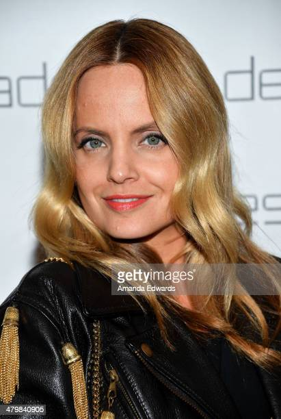 Actress Mena Suvari arrives at the Decades Les Must De Moschino event at Decades on March 20 2014 in Los Angeles California