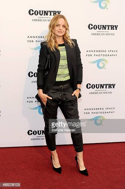 Actress Mena Suvari attends the Annenberg Space for Photography Opening Celebration for Country Portraits of an American Sound at the Annenberg Space...