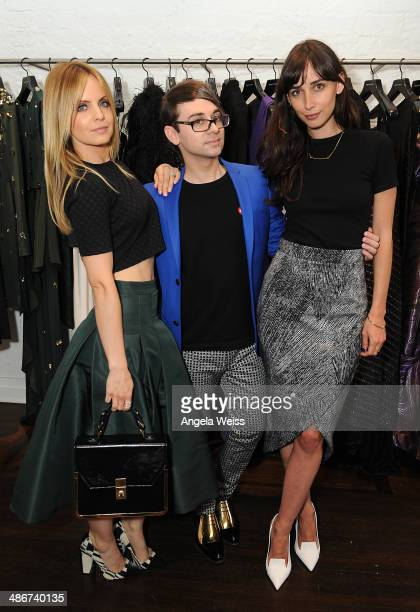 Actress Mena Suvari designer Christian Siriano and actress Rebecca Dayan attend Christian Siriano Fall 2014 LA preview cocktail party at Decades on...