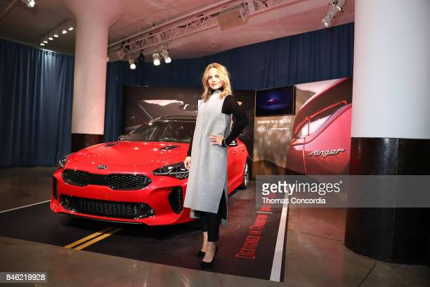 Actress Mena Suvari poses with Kia as she attends Kia STYLE360 Hosts MOMENTUM by Timo Weiland for Crowne Plaza at Metropolitan West on September 12...