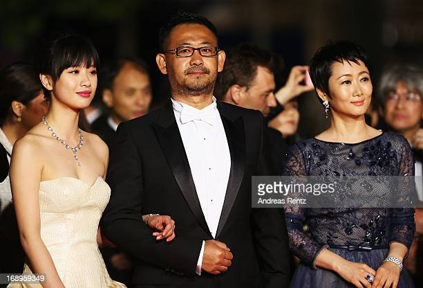 Actress Meng Li actor Jiang Wu and actress Tao Zhao attend the Premiere of 'Tian Zhu Ding' during The 66th Annual Cannes Film Festival at Palais des...